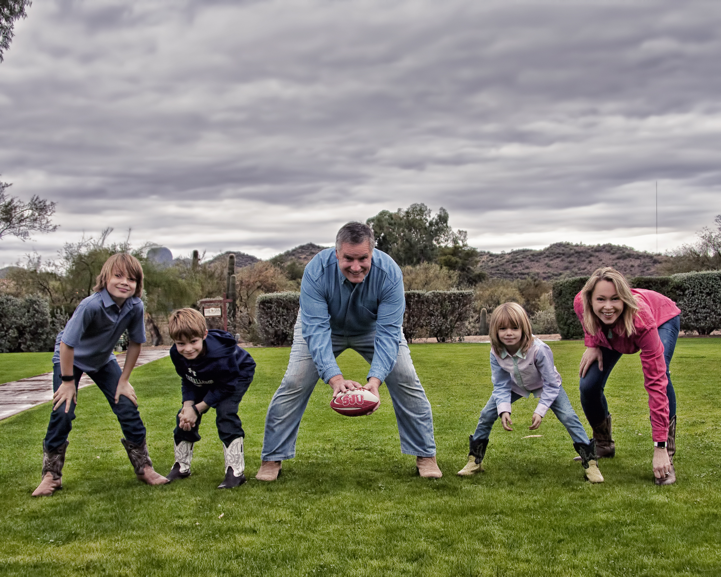 Jon Schwingler (center) and family hunched in football formation