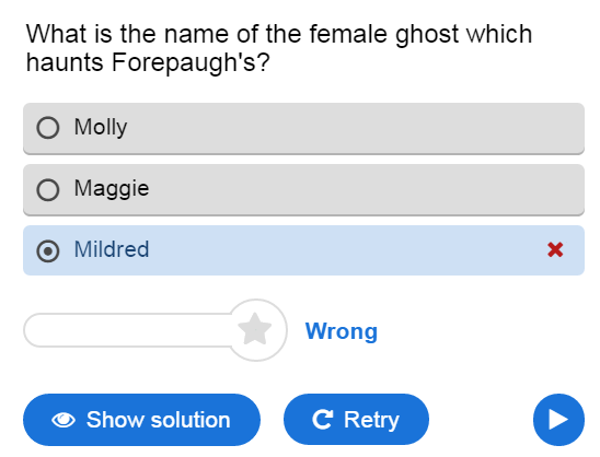 "Shows the wrong answer ""Mildred"" with red x next to the answer and ""Wrong"" at the bottom."